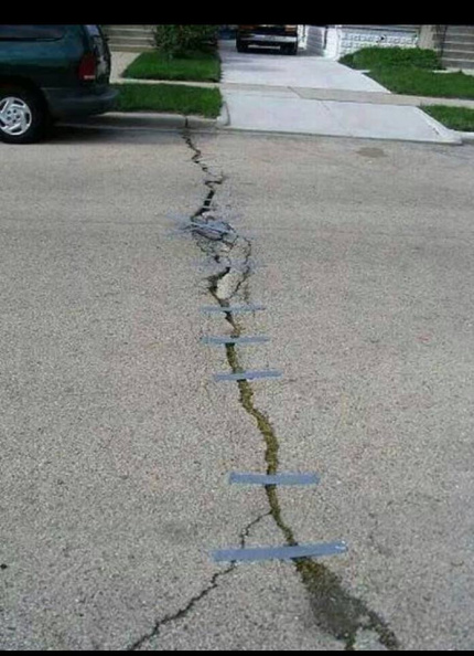 taping_cracks_in_the_road.jpg